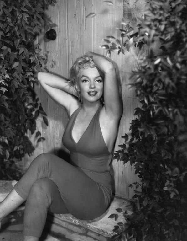 . 1954:  Marilyn Monroe (1926 - 1962), the Hollywood film actress enjoying a seductive stretch.  (Photo by Baron/Getty Images)
