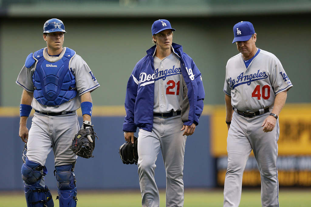. MILWAUKEE, WI - MAY 21: Zack Greinke #21 of the Los Angeles Dodgers walks to the dugout with catcher A.J. Ellis and pitching coach Rick Honeycutt #40 before the game against the Milwaukee Brewers at Miller Park on May 21, 2013 in Milwaukee, Wisconsin. (Photo by Mike McGinnis/Getty Images)