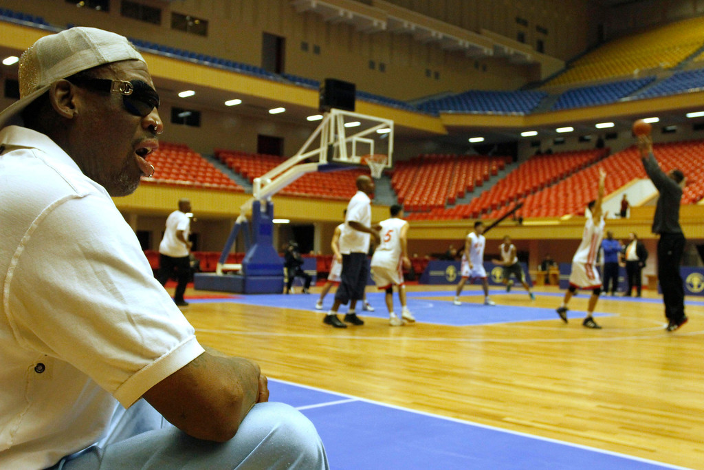 . Dennis Rodman watches court side as North Korean and U.S. basketball players practice in Pyongyang, North Korea on Tuesday, Jan. 7, 2014. Rodman came to the North Korean capital with a squad of U.S. basketball stars for an exhibition game on Jan. 8, the birthday of North Korean leader Kim Jong Un.  (AP Photo/Kim Kwang Hyon)