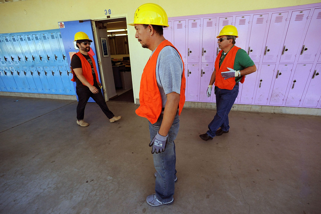 . Members of the Security and Utilities team check for gas leaks at Millikan Middle School while participating in the Great American Shakeout in Sherman Oaks, CA, October 17, 2013.  (Andy Holzman/Los Angeles Daily News)