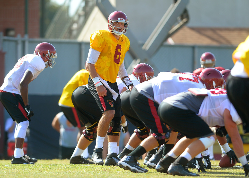 . USC quarterback Cody Kessler works out during a practice at the Howard Jones Field at USC Monday August 19, 2013.  The Trojans start the season on August 29th with a game against Hawaii.(Andy Holzman/Los Angeles Daily News)