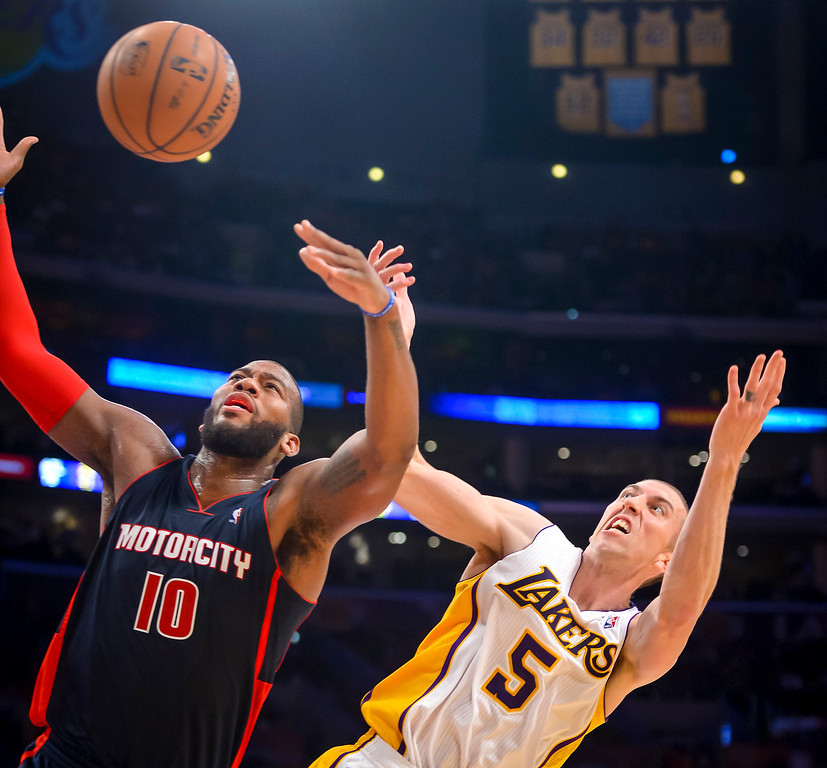 . Detroit�s Greg Monroe and Lakers� Steve Blake go after a rebound during second half action at Staples Center Sunday, November 17, 2013.  The Lakers defeated the Detroit Pistons 114-99.  ( Photo by David Crane/Los Angeles Daily News )
