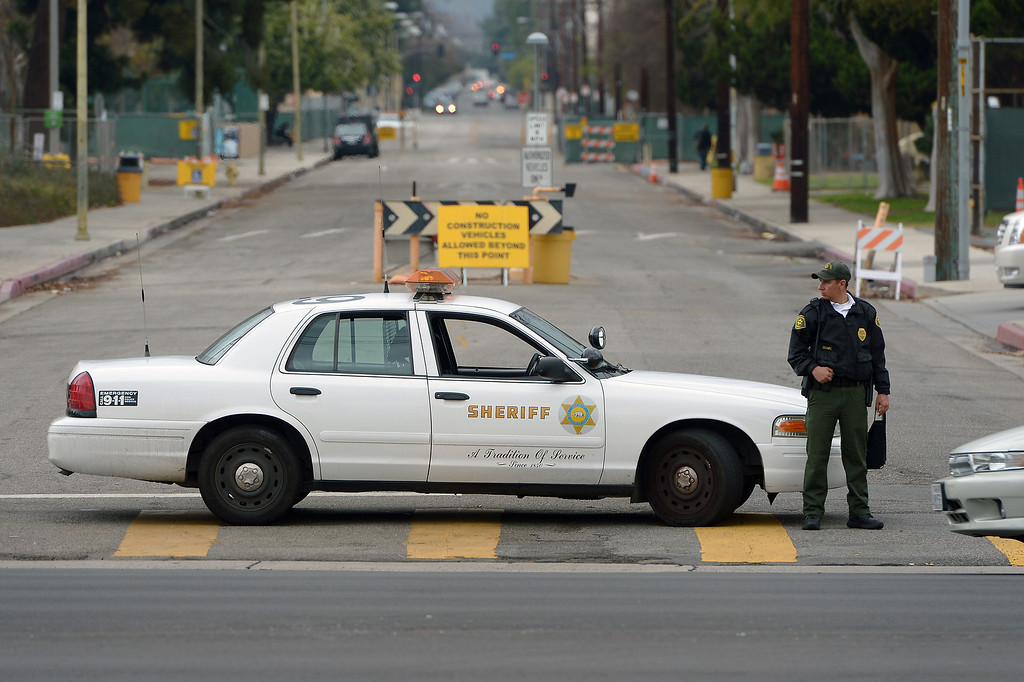 . A security guard for L.A. County Sheriffs blocks an entrance to Valley College after the campus was closed due to a shooting threat, Thursday, February 6, 2014. A 19-year-old woman was arrested just before 11 a.m. in connection with a phone call threatening a shooting on the campus that prompted the cancellation of all classes Thursday morning. (Photo by Michael Owen Baker/L.A. Daily News)