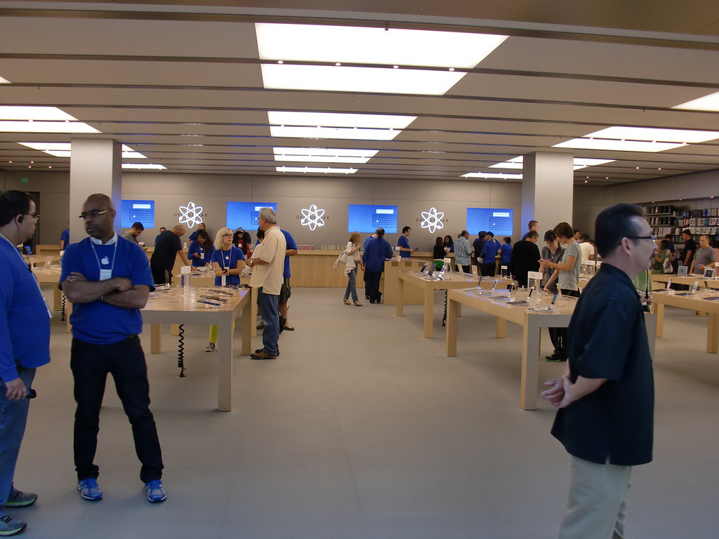 . The Apple Store at Westfield Topanga in Canoga Park wasn\'t terrible crowded inside at 9:30 a.m. Friday, Sept. 20, 2013, when the iPhone 5c and 5s went on sale. That\'s because there were about 100 or so people in line outside the store who were being escorted by Apple Store employees into the space one by one. (Photo by Steven Rosenberg/Los Angeles Daily News)