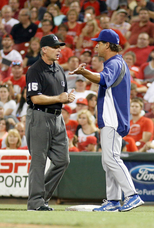 . Los Angeles Dodgers manager Don Mattingly, right, has words with first base umpire Ed Hickox, left, during a baseball game, Sunday, Sept. 8, 2013, in Cincinnati. (AP Photo/David Kohl)
