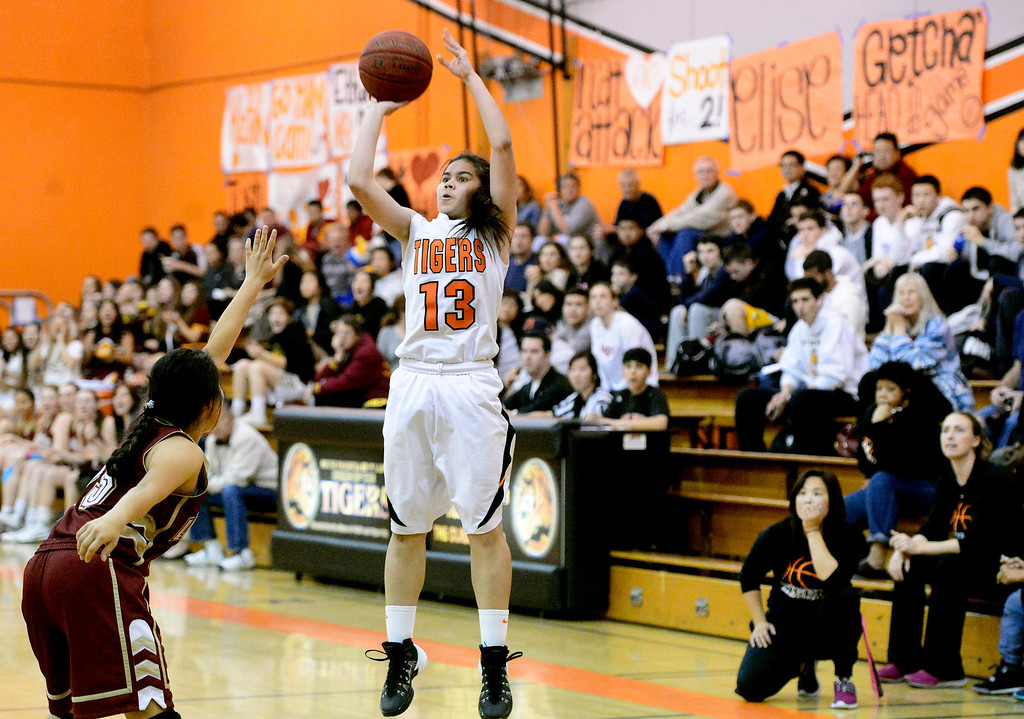 . South Pasadena\'s Lexie Scholtz (13) goes for a shot as they defeat La Canada 66-58 Friday night, January 31, 2014 at South Pasadena High School. (Photo by Sarah Reingewirtz/Pasadena Star-News)