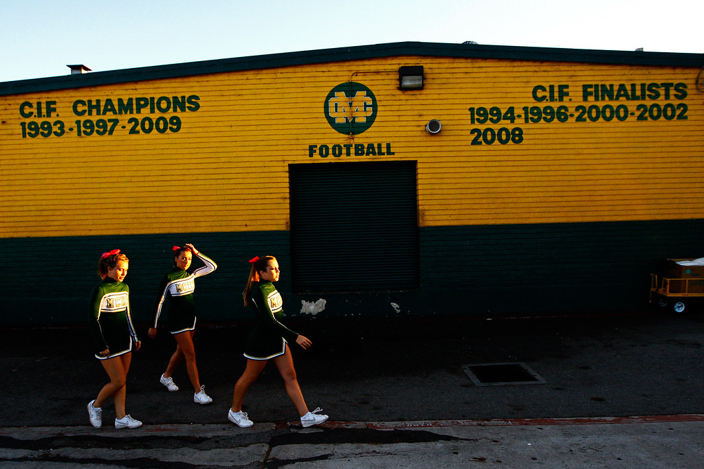 . Members of the Mira Costa cheerleading squad walk to the field before kickoff against Palos Verdes in a Bay League matchup at Mira Costa High School on Friday, October 18, 2013 in Manhattan Beach, Calif.  (Michael Yanow / For the Daily Breeze)