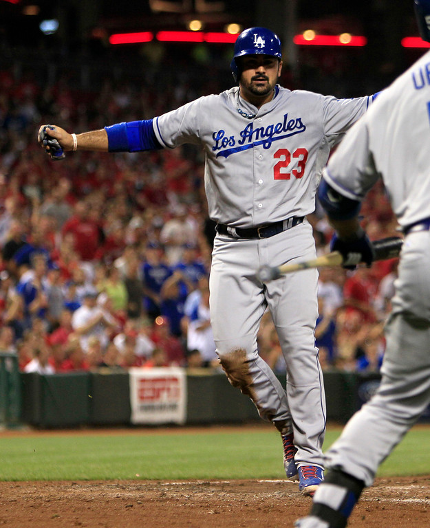 . Los Angeles Dodgers\' Adrian Gonzalez scores at home after Hanley Ramirez double hit off Cincinnati Reds pitcher Homer Bailey in the fourth inning during a baseball game, Sunday, Sept. 8, 2013, in Cincinnati. (AP Photo/David Kohl)