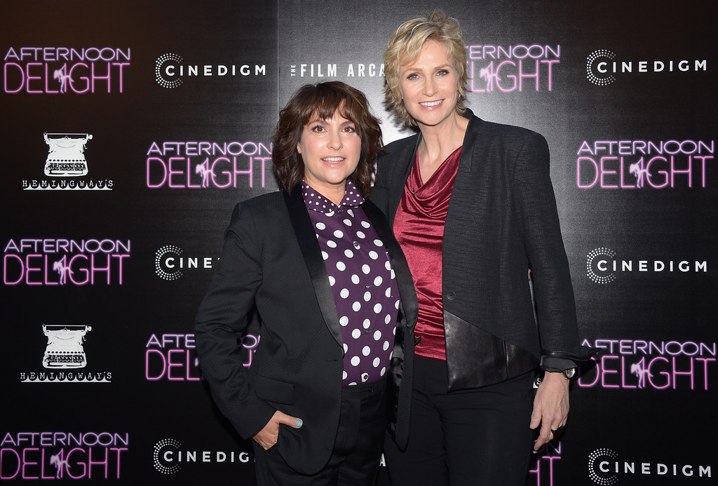 ". Director/writer Jill Soloway (L) and actress Jane Lynch (R) arrive for the Los Angeles premiere of ""Afternoon Delight\"" at  the  Arclight Theatre in Hollywood, California on August 19, 2013.           ( JOE KLAMAR/AFP/Getty Images)"