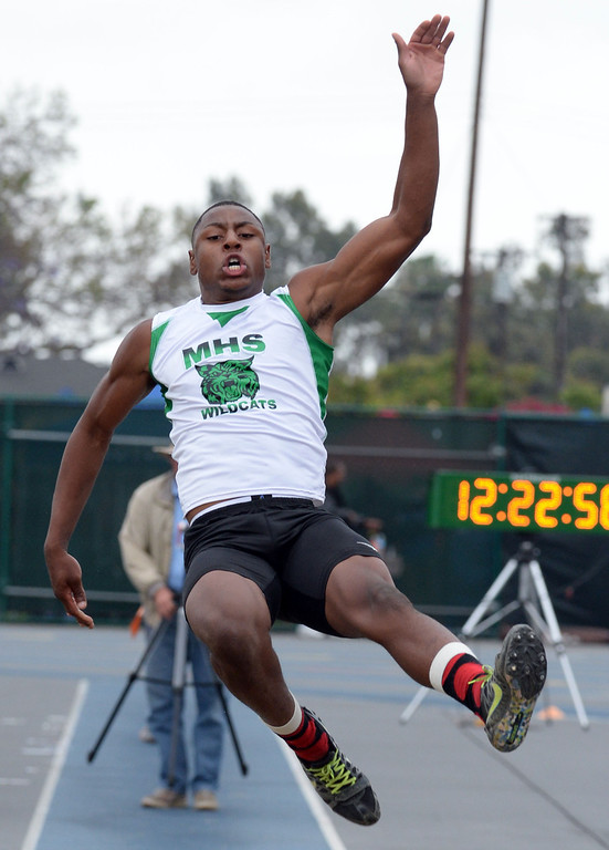 . Monrovia\'s Octavius Spencer competes in the Division 3 long jump during the CIF Southern Section track and final Championships at Cerritos College in Norwalk, Calif., Saturday, May 24, 2014. 