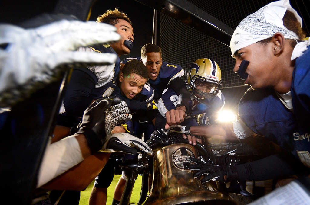 . Muir rings the bell after defeating Pasadena 32-21 during the annual Turkey Tussle Friday night, November 8, 2013 at the Rose Bowl in Pasadena. (Photo by Sarah Reingewirtz/Pasadena Star-News)