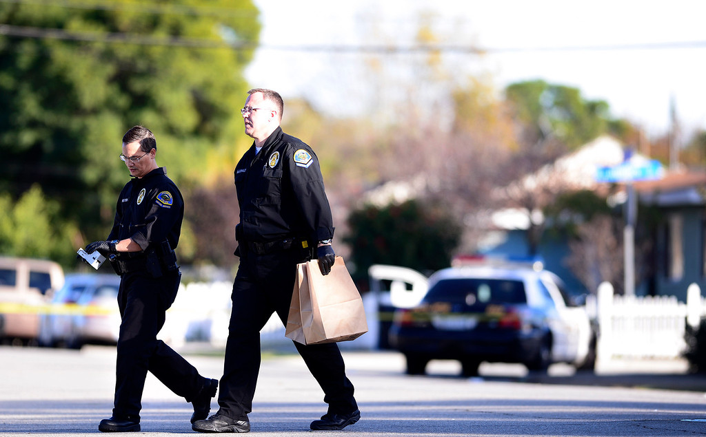 . Pomona Police detectives investigate a shooting of a teenage girl in the 1000 block of Laurel Avenue in Pomona Saturday, November 30, 2013.  The city has been plagued by violence, with 27 homicides this year. Police are offering $10,000 rewards for information leading to conviction in any of this year\'s unsolved killings. (Photo by Sarah Reingewirtz/Pasadena Star-News)