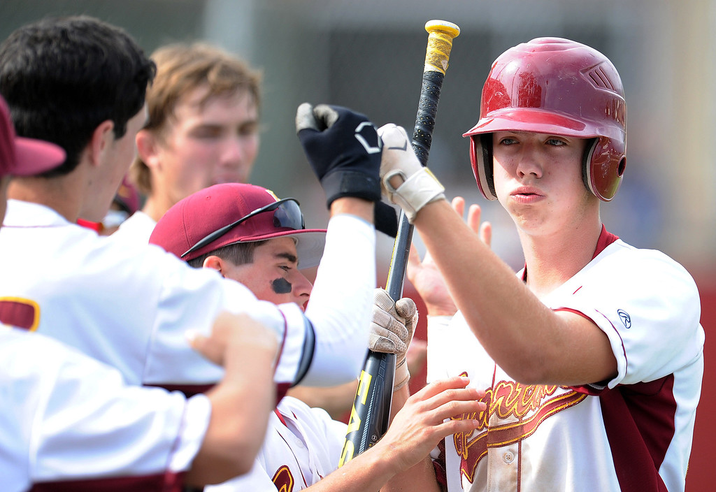 . La Canada\'s Scott Moulin high fives teammates after scoring in the fourth inning of a CIF-SS playoff baseball game against California at La Canada High School on Thursday, May 16, 2013 in La Canada, Calif. La Canada won 4-2.  (Keith Birmingham Pasadena Star-News)