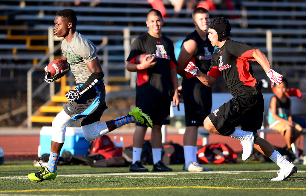 . Local high school football teams play in the Bonita Passing Tournament Friday evening at Bonita High School in La Verne, on June 28, 2013. (SGVN/Staff Photo by Sarah Reingewirtz)