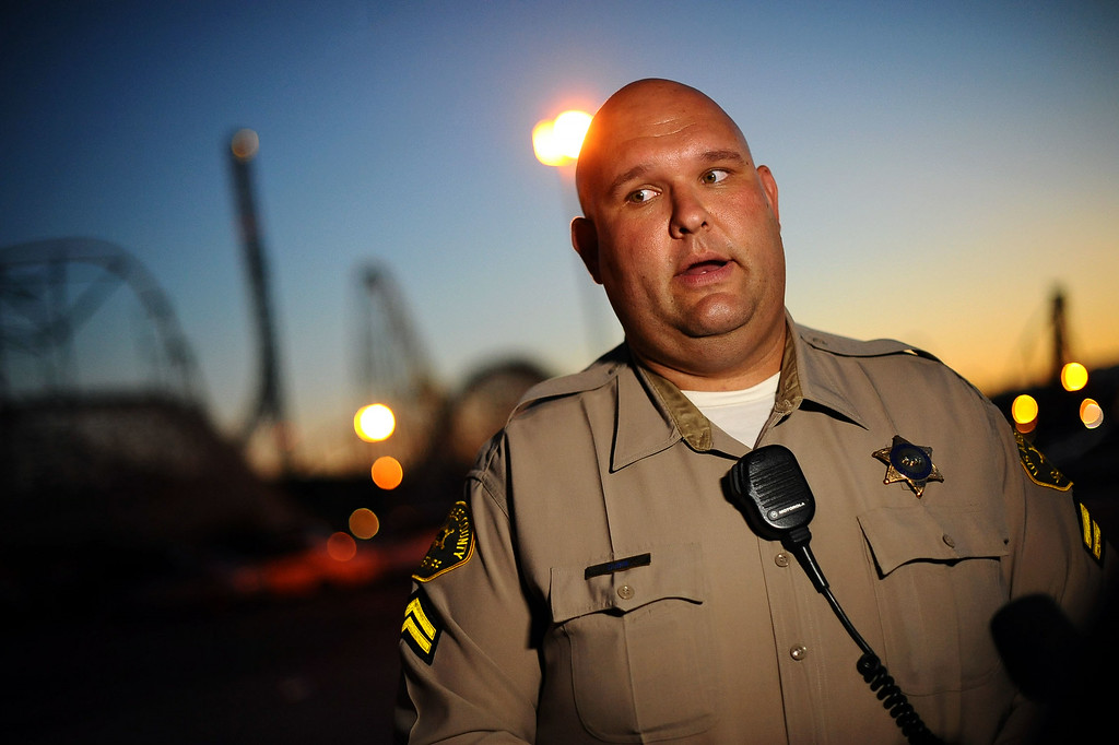 . Deputy Joshua Dubin gives details regarding the rollercoaster accident at Six Flags Magic Mountain July 7, 2014 in Valencia.  Riders were injured after a tree limb fell on the track around 5:30 PM Monday.(Andy Holzman/Los Angeles Daily News)