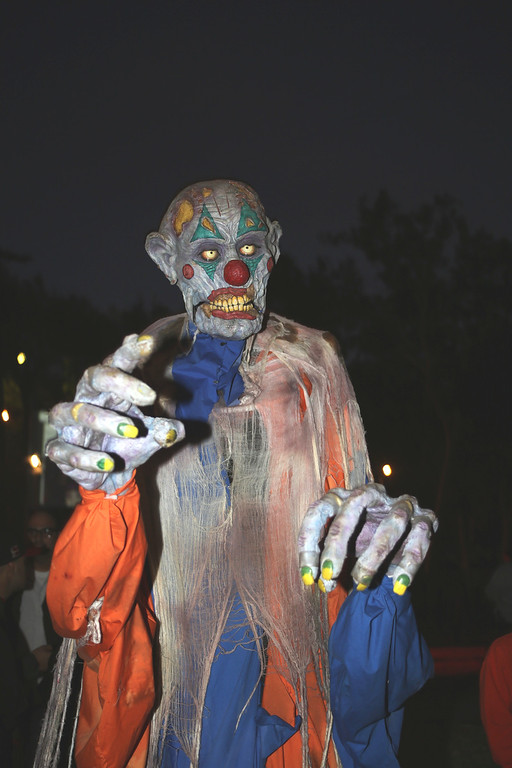 . A walking clown actor at the 5th Annual Los Angeles Haunted Hayride Premiere Night on October 10, 2013.  The fifth year anniversary of the Los Angeles Haunted Hayride took Hayriders through scenes of actual hauntings.  The month-long event will once again take place in Griffith Park�s Old Zoo area, which has been home to murder, torture, paranormal activity, serial killers, and abduction. (Photos by Boris Issaei for the Los Angeles Daily News)