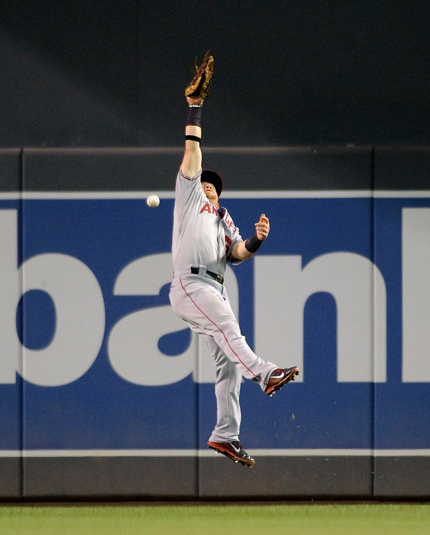 . MINNEAPOLIS, MN - SEPTEMBER 9: Kole Calhoun #56 of the Los Angeles Angels of Anaheim misses the catch of the double hit by Josmil Pinto #43 of the Minnesota Twins during the eighth inning of the game on September 9, 2013 at Target Field in Minneapolis, Minnesota. The Twins defeated the Angels 6-3. (Photo by Hannah Foslien/Getty Images)