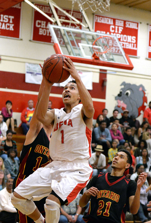 . Pasadena\'s Ajon Efferson (1) drives to the basket against Ontario in the first half of a prep playoff game at Pasadena High School in Pasadena, Calif., on Friday, Feb.21, 2014. (Keith Birmingham Pasadena Star-News)