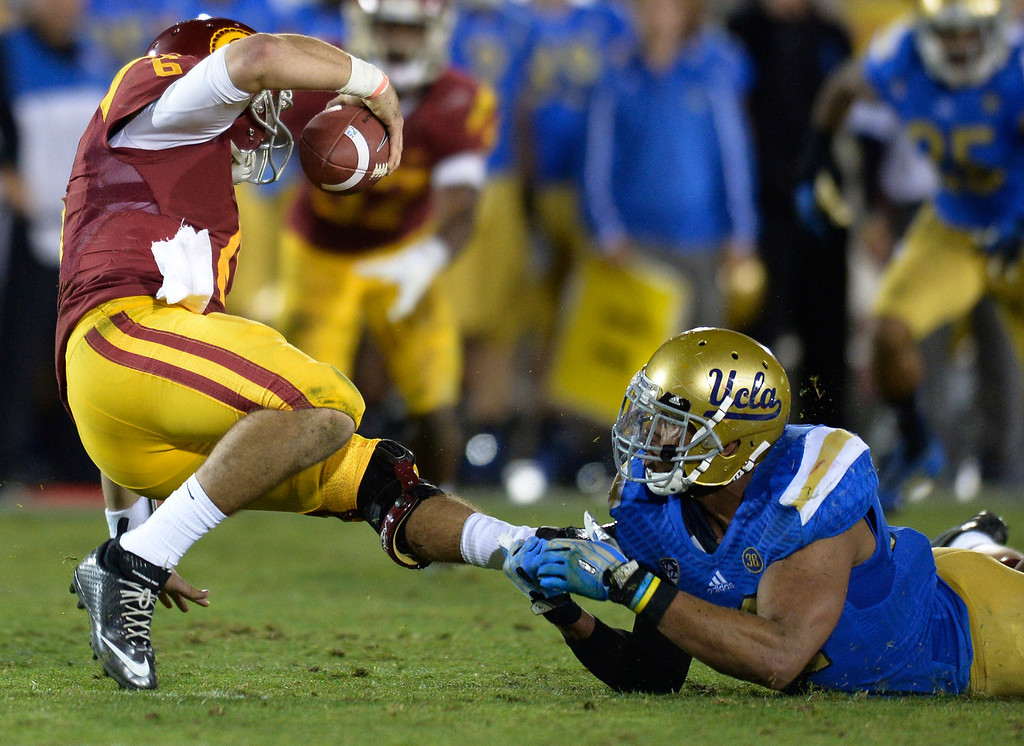 . USC QB Cody Kessler is sacked by a shoestring in the 4th quarter UCLA defeated USC 35 to 14 in a matchup of cross town rivals at the Los Angeles Memorial Coliseum in Los Angeles, CA.  photo by (John McCoy/Los Angeles Daily News)