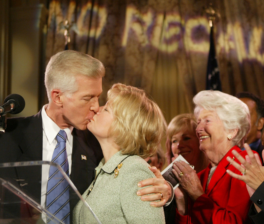. LOS ANGELES - OCTOBER 7:   California Governor Gray Davis kisses his wife Sharon as Davis\' mother Doris Morrell (R) looks on during his concession speech to supporters after learning he has lost the California gubernatorial recall election to actor Arnold Schwarzenegger at the Millennium Biltmore Hotel in the Crystal Ballroom, October 7, 2003 in Los Angeles, California.  (Photo by David McNew/Getty Images)