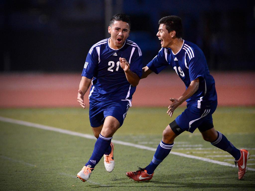 . Anaheim\'s Francisco Santana (21) and Daniel Viral (19) celebrate their second goal as they defeat Arcadia 2-0 during the quarterfinals at Arcadia High School Thursday, February 27, 2014. (Photo by Sarah Reingewirtz/Pasadena Star-News)