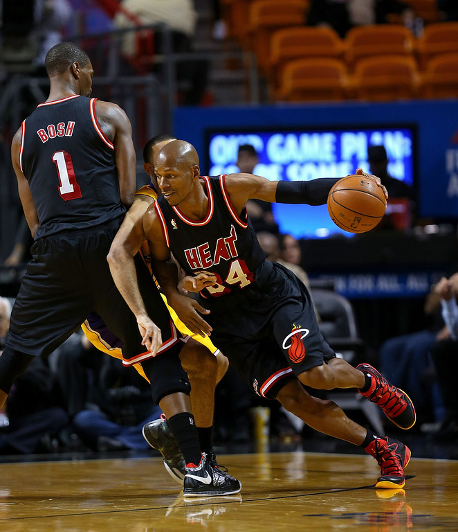 . Ray Allen #34 of the Miami Heat drives around Chris Bosh #1 during a game against the Los Angeles Lakers at American Airlines Arena on January 23, 2014 in Miami, Florida.  (Photo by Mike Ehrmann/Getty Images)