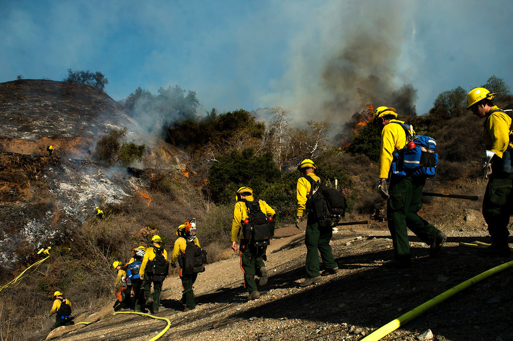 . Firefighters battle the Colby Fire above Glendora, Calif. on Thursday, Jan. 16, 2014. (Photo by Watchara Phomicinda/ San Gabriel Valley Tribune)