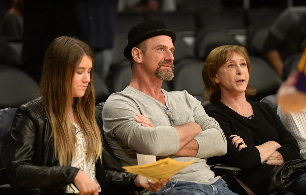 . US actor Christopher Melonia (C) and his daughter Sophia (L) attend the Los Angeles Lakers versus New Orleans Pelicans NBA game at the Staples Center in Los Angeles, California, USA, 04 March 2014.  Woman at right is unidentified.  EPA/MICHAEL NELSON
