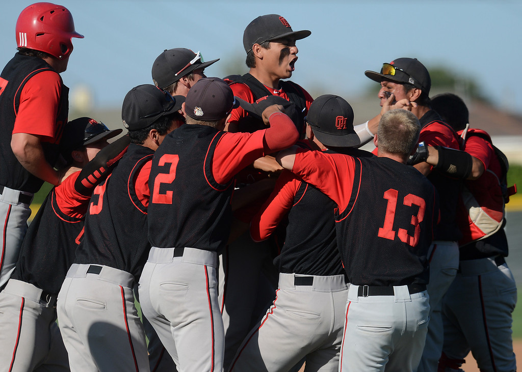 . 0530_SPT_IDB_L-BASEBALL-01-JCM (Jennifer Cappuccio Maher/Staff Photographer) Oak Hills celebrates their win over Ontario Christian Wednesday, May 29, 2013, at Ontario Christian High School in Ontario. Oak Hills defeated Ontario Christian 5-4 to go on to the finals.