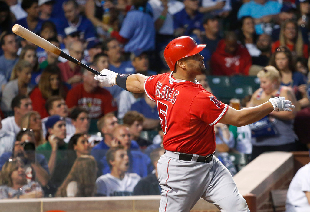 . Los Angeles Angels\' Albert Pujols watches his two-run home run off Chicago Cubs starting pitcher Jeff Samardzija during the fifth inning of an interleague baseball game Wednesday, July 10, 2013, in Chicago. (AP Photo/Charles Rex Arbogast)
