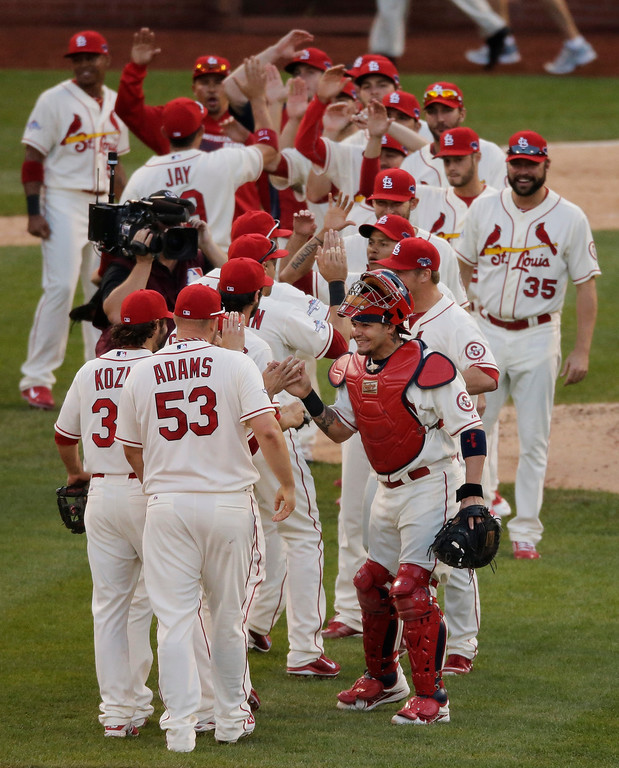 . The St. Louis Cardinals celebrate after Game 2 of the National League baseball championship series against the Los Angeles Dodgers Saturday, Oct. 12, 2013, in St. Louis. Cardinals won 1-0 to take a 2-0 lead in the series. (AP Photo/Chris Carlson)