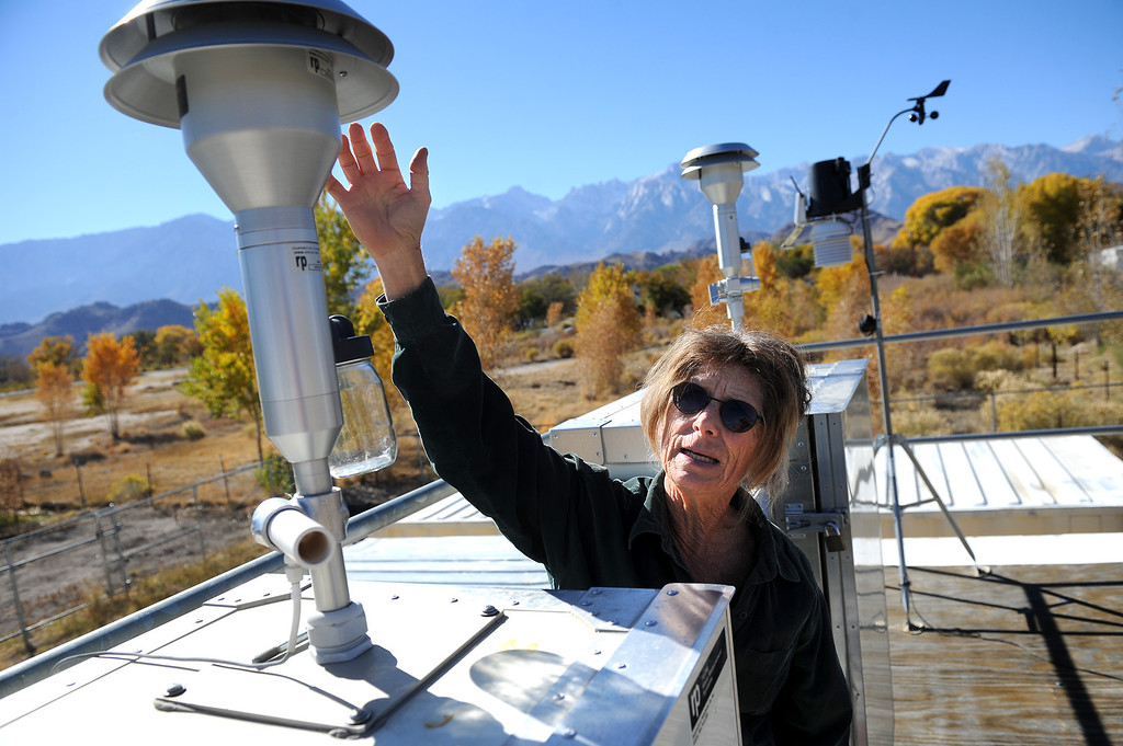 . April Zrelak, air quality coordinator for the Lone Pine Paiute-Shoshone tribe, shows a monitor that measures the air particulate from dust storms caused by the dry lakebed of the Owens Lake. (Photo by Michael Owen Baker/L.A. Daily News)