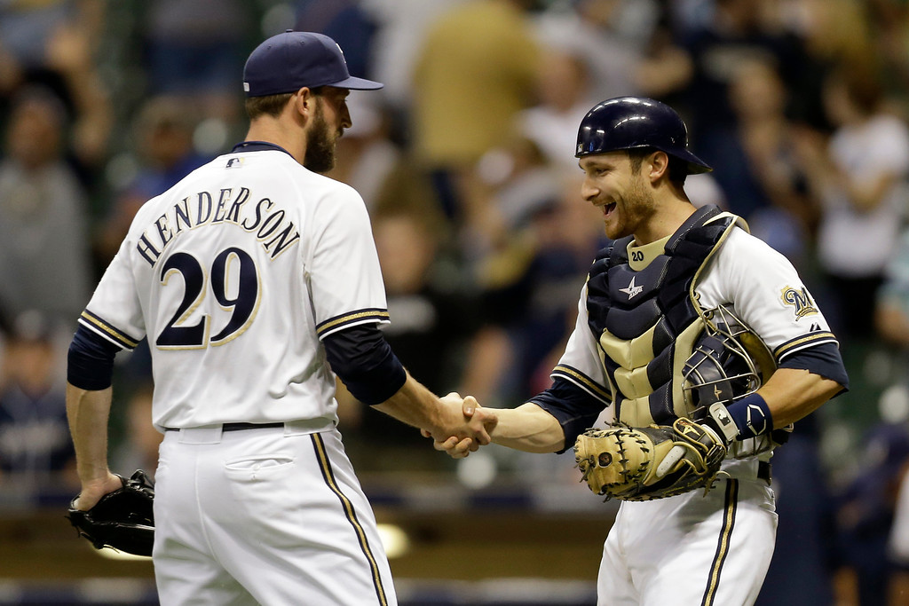 . MILWAUKEE, WI - MAY 21: Jim Henderson #29 of the Milwaukee Brewers celebrates with Jonathan Lucroy #20 after the 5-2 win over the Los Angeles Dodgers at Miller Park on May 21, 2013 in Milwaukee, Wisconsin. (Photo by Mike McGinnis/Getty Images)