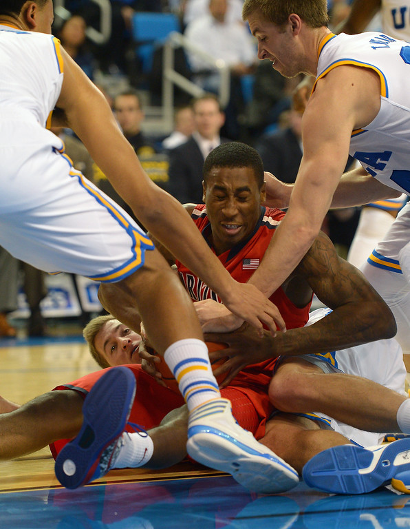 . Arizona\'s Rondae Hollis-Jefferson is tied up by UCLA\'s Kyle Anderson, left, Travis Wear, right, and David Wear, back, before calling timeout, Thursday, January 9, 2014, at Pauley Pavilion. (Photo by Michael Owen Baker/L.A. Daily News)