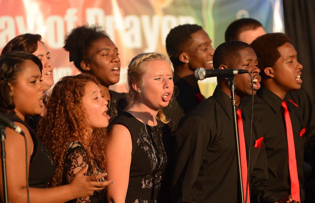 . The Azusa Pacific University Gospel Choir sings at the Pomona Day Of Prayer Sunday November 10, 2013 at Ganesha High School Nancy McCracken stadium in Pomona.LaFonzo Carter/ Staff Photographer