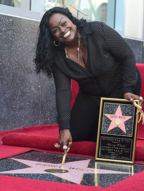 . The late Barry White\'s wife Glodean White points to his star following the unveiling of her husband\'s posthumous star along the Hollywood Walk of Fame on September 12, 2013. White, who died in 2003 and would have celebrated his birthday September 12, is most well known for his 1970\'s instrumental \'Love\'s Theme\' and is the recipient of the 2,506th Star in the category of recording.        (FREDERIC J. BROWN/AFP/Getty Images)