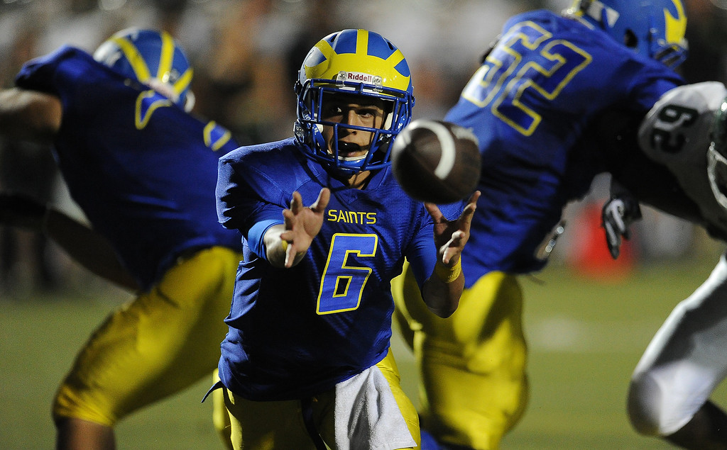 . San Dimas quarterback Josh Avila (6) shuffle passes against Bonita in the first half of a prep football game at Citrus College on Thursday, Aug. 29, 2013 in Glendora, Calif.   (Keith Birmingham/Pasadena Star-News)