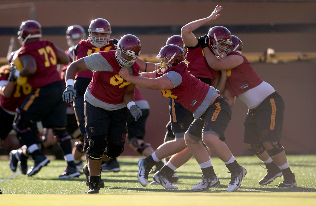 . Lineman drill during practice at USC, Howard Jones Field on the USC campus in Los Angeles, Monday, August 4, 2014. (Photo by Hans Gutknecht/Los Angeles Daily News)