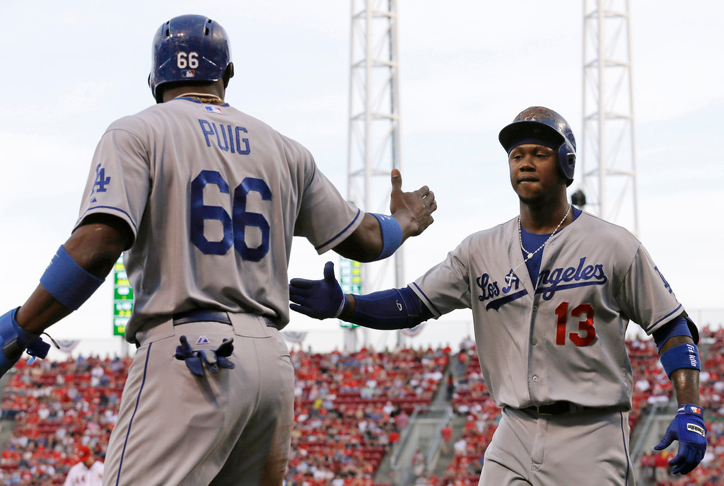 . Los Angeles Dodgers\' Hanley Ramirez (13) is congratulated by Yasiel Puig (66) after Ramirez hit a two-run home run off Cincinnati Reds starting pitcher Mike Leake in the first inning of a baseball game, Friday, Sept. 6, 2013, in Cincinnati. (AP Photo/Al Behrman)