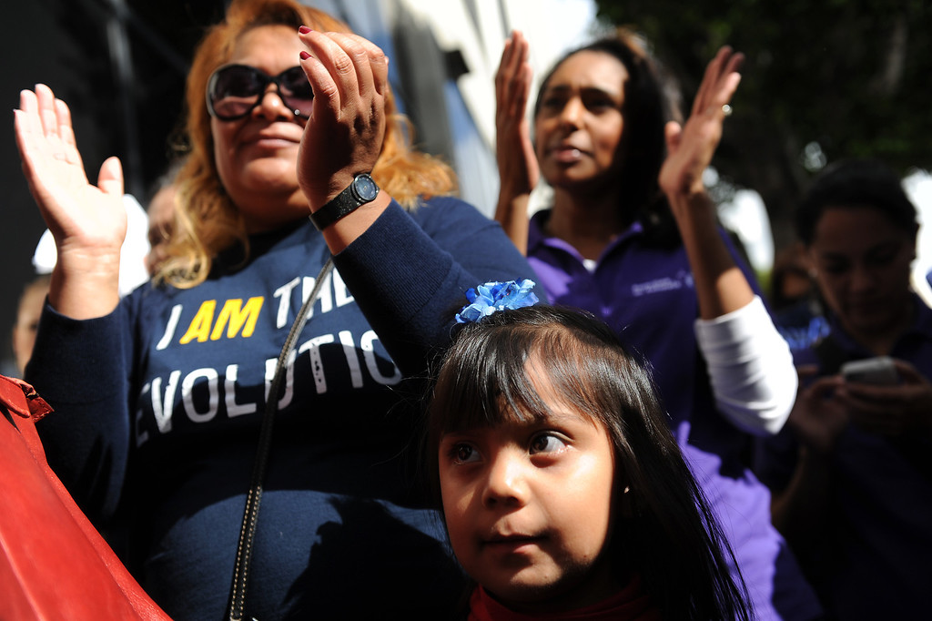 . Ali Guzman, 3, stands with her mother Erica Guzman, left, at a rally supporting LAUSD Superintendent John Deasy in front of LAUSD headquarters, Tuesday, October 29, 2013. (Photo by Michael Owen Baker/L.A. Daily News)