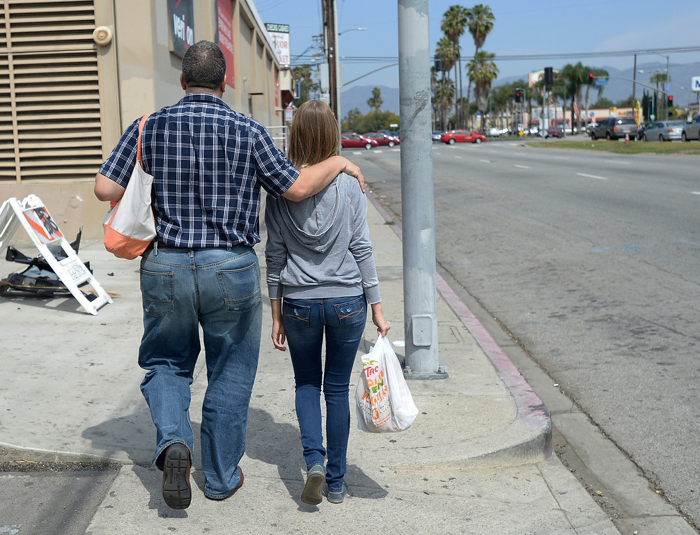 . Joe and Lexi Di Benedetto walk down Sepulveda Blvd. looking for somebody to give to. Our Lady of Peace Parish and School hosted its first Love It Forward Event. Members of the parish, and community, went out into the streets to spread love with simple, random acts of kindness. North Hills, CA. March 29, 2014 (Photo by John McCoy / Los Angeles Daily News)