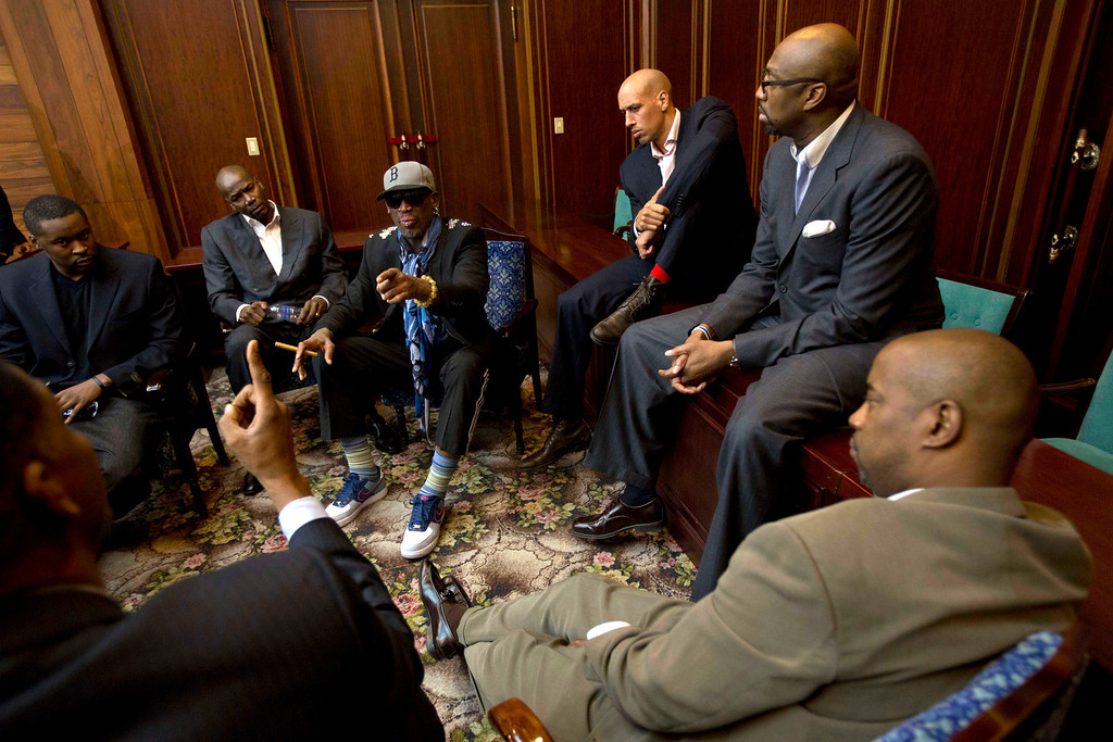 . Dennis Rodman speaks with fellow US basketball players during a team meeting at a Pyongyang, North Korea hotel Tuesday, Jan. 7, 2014. Rodman came to the North Korean capital with a team of USA basketball stars for an exhibition game on Jan. 8, the birthday of North Korean leader Kim Jong Un. Clockwise from bottom left are Charles D. Smith, unidentified, Cliff Robinson, Rodman, Doug Christie, Vin Baker, and unidentified. (AP Photo/David Guttenfelder)