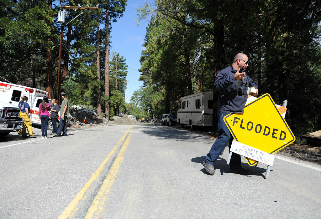 . Valley of the Falls Road is re-opened allowing hikers and visitors to return home on Monday, August 4, 2014 in Forest Falls, Ca. Sunday\'s flash flood caused closure of the road and damage to multiple homes. (Micah Escamilla/San Bernardino Sun)