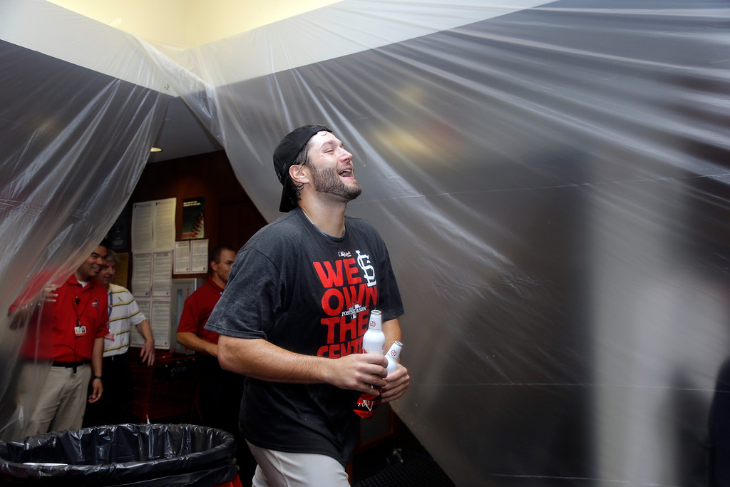 . St. Louis Cardinals starting pitcher Lance Lynn celebrates after the Cardinals\' 7-0 win over the Chicago Cubs in a baseball game Friday, Sept. 27, 2013, in St. Louis. The Cardinals clinched the NL Central title. (AP Photo/Jeff Roberson)