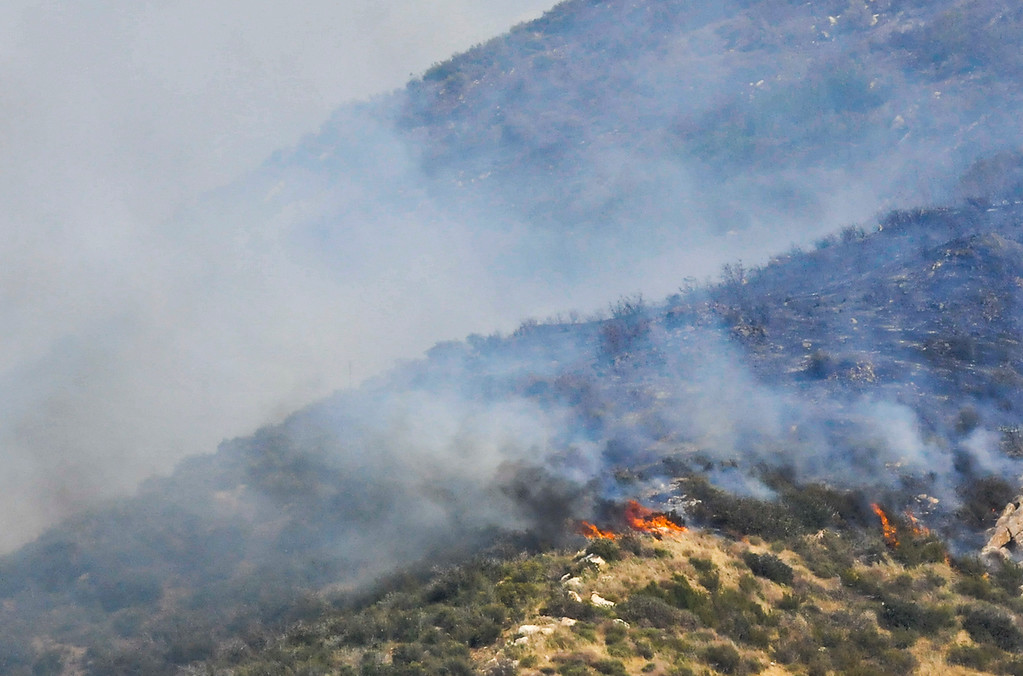 . A fire burns in the canyons along Highway 243 south of Banning on Saturday, May 4, 2013. More than 400 firefighters battled the 650-acre fire on Saturday. (Rachel Luna / Staff Photographer)