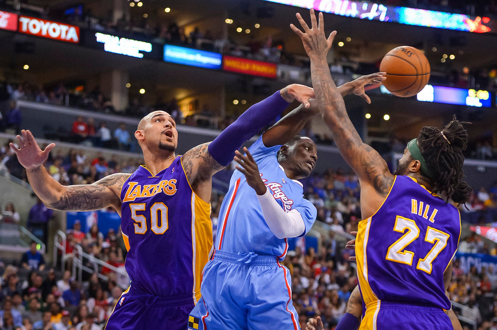 . Lakers� Robert Sacre and Jordan Hill try to get a pass from Clippers Darren Collison during game action at Staples Center Sunday April 6, 2014. Clippers defeated the Lakers 120-97.  ( Photo by David Crane/Los Angeles Daily News )