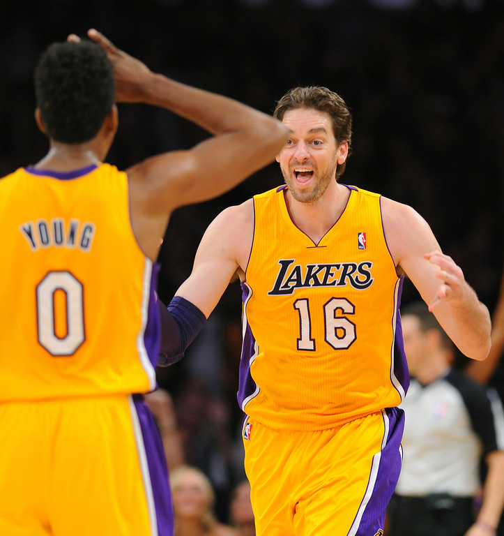 . Lakers Pau Gasol and Nick Young celebrate Gasol\'s three-pointer in the fourth quarter against the Timberwolves, Friday, December 20, 2013, at Staples Center. (Photo by Michael Owen Baker/L.A. Daily News)