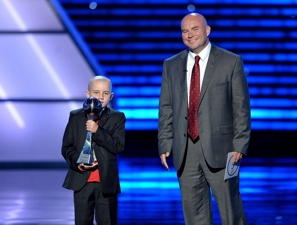 . Jack Hoffman, left, accepts the award for best moment at the ESPY Awards on Wednesday, July 17, 2013, at Nokia Theater in Los Angeles. At right is Andy Hoffman. (Photo by John Shearer/Invision/AP)