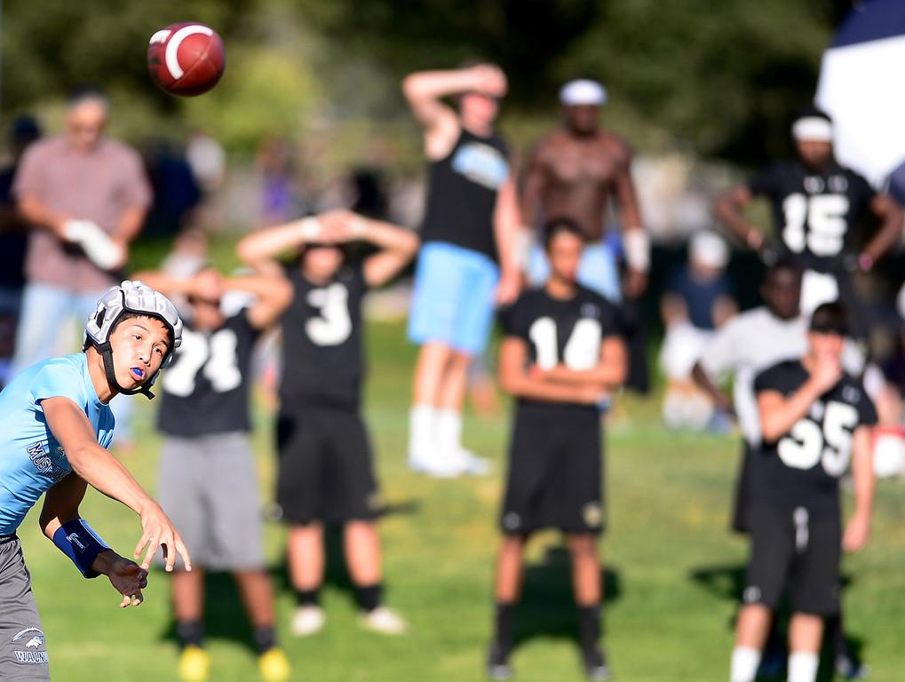 . Local high school football teams play in the Bonita Passing Tournament Friday evening at Bonita High School in La Verne, on June 28, 2013. (SGVN/Staff Photo by Sarah Reingewirtz)