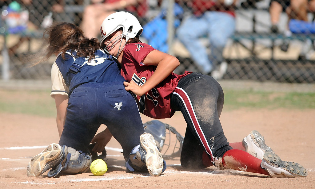 . Alemany\'s Danielle Ortega is safe at home during a close play at home with Notre Dame catcher Marianna Politis during their Mission League softball showdown in Encino, CA April 8, 2014.  Alemany won the game, 5-4.(Andy Holzman/Los Angeles Daily News)